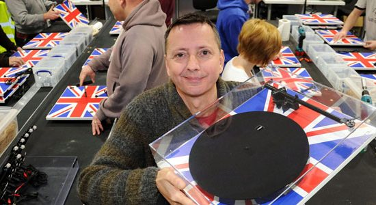 Rega Research accountant John Tozer with one of the company's Union Jack turntables manufactured in Southend.