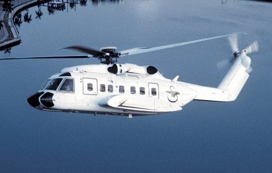 A Sikorsky S-92 helicopter, on which the new presidential aircraft will be based, climbs over intracoastal waterway