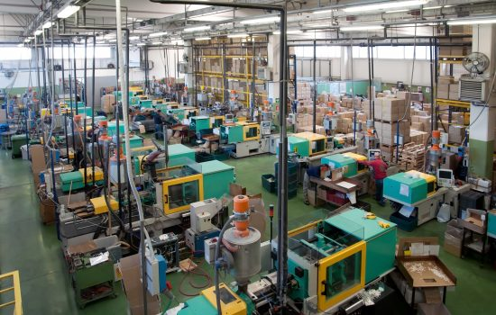 Injection moulding machines in a large factory - image courtesy of DFC