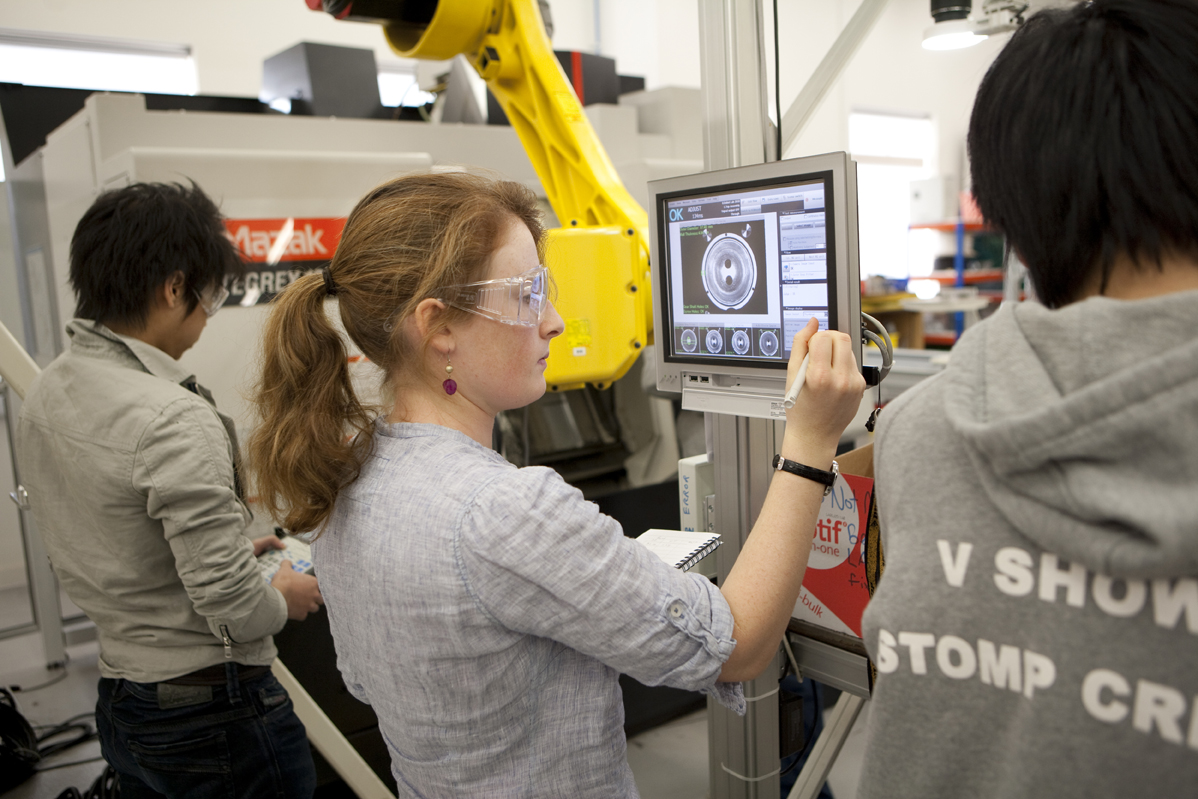 Students using an Omron FZ3H vision system in the Automation Lab