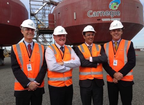RENA CEO Ivor Frischknecht, Minister for Industry Ian Macfarlane, Carnegie Wave Energy's Dr Michael Ottaviano and Grant Mooney in front of the CETO wave units