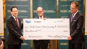 Doosan and Bobcat Company present a check to NDSU signifying their $3m share of the scholarship endowment contribution.