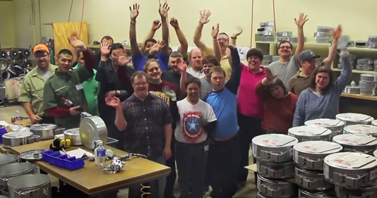 Lifeworks workers help recycle used Stratasys canisters - image courtesy of Stratasys.