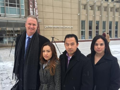 Bob Hilliard and the Lee Family outside the courtroom - image courtesy of Hilliard Munoz Gonzales LLP.