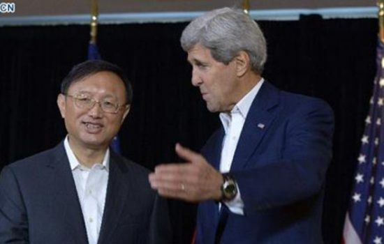 State Councillor Yang Jiechi (L) and US Secretary of State John Kerry speak to reporters prior to a meeting in Boston, Massachusetts, the United States, Oct 18, 2014 - image courtesy of News.cn