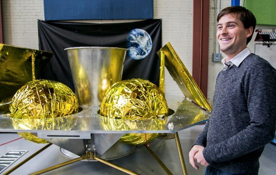 John Thornton, CEO of team Astrobotic, with their Griffin Moon lander after their big milestone prizes win in the Google Lunar XPrize - image courtesy of Google.