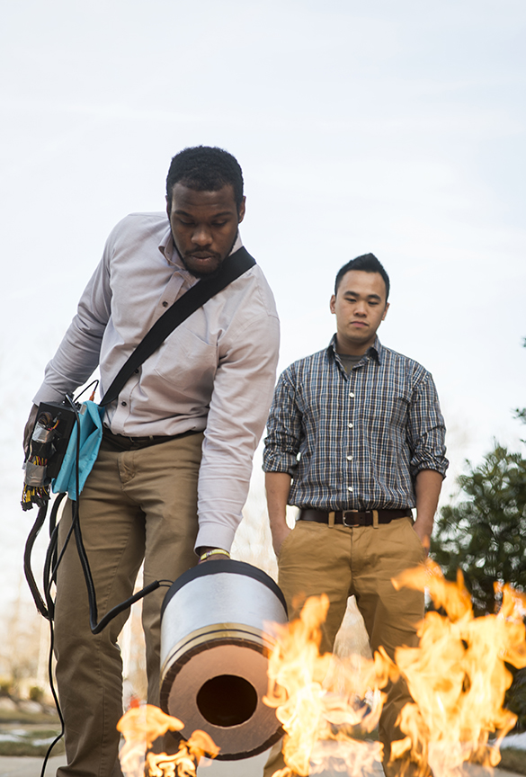 Seth Robertson and Viet Tran, electrical and computer engineering students, test their sound-blasting fire extinguisher prototype. Evan Cantwell/Creative Services/George Mason University