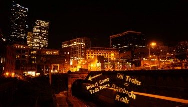 350 Seattle & Backbone Campaign have called for a stop to all Oil by rail transport and in 2013 used Guerrilla Light Projection and other creative tactics to throw a spotlight on the issue - image courtesy of Backbone Campaign via Flickr.