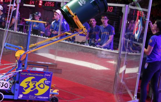 Students compete in the FIRST Robotics Challenge. Image courtesy of FIRST