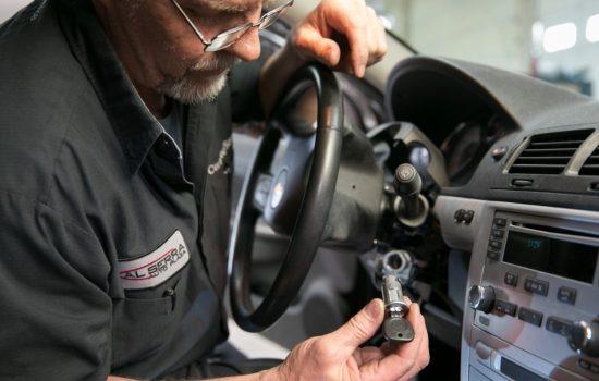 Gary Pittam performs recall service on a Chevrolet Cobalt Thursday, April 17, 2014, at Al Serra Chevrolet in Grand Blanc, Michigan.