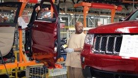 An employee at Jefferson North Assembly Plant installs a door on the Jeep Grand Cherokee - image courtesy of Fiat Chrysler
