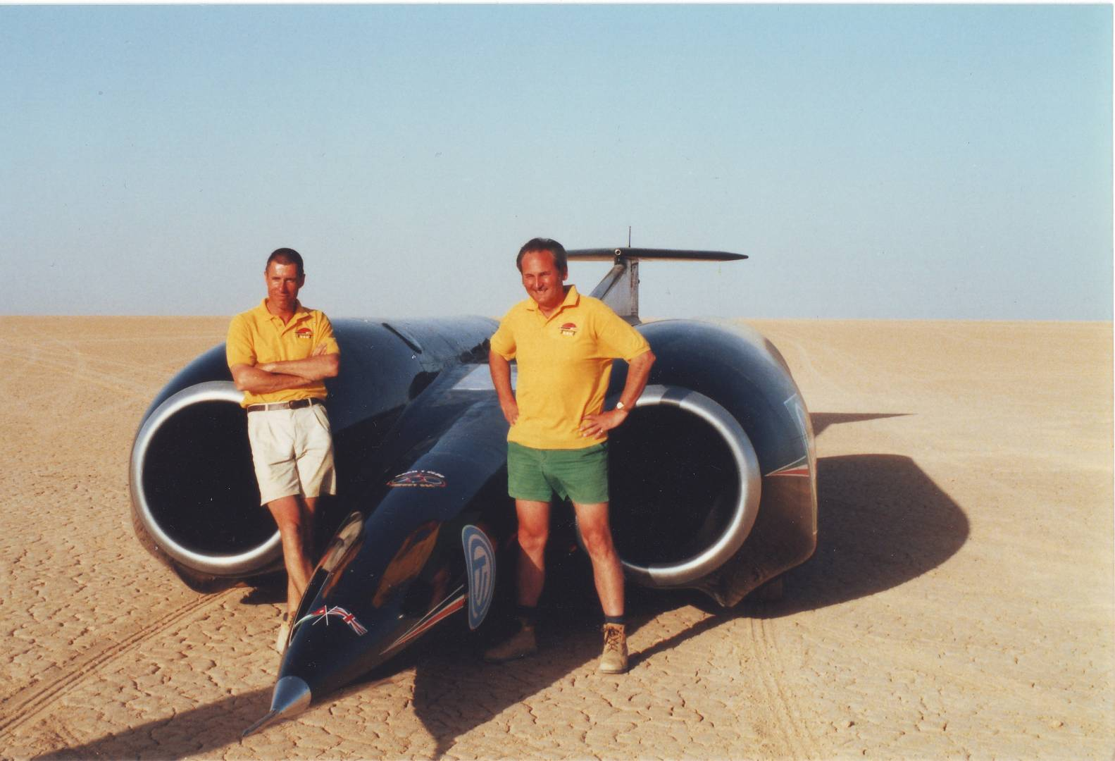 Noble with Andy Green (L) and the current land speed record vehicle – Thrust SSC – on the flats in Black Rock, Nevada (image courtesy of Mike Varndell)