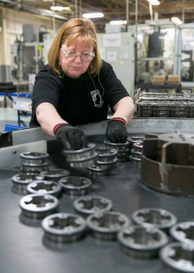 Penny Averill works with precision-machined exhaust stators at GM Components Grand Rapids plant in Wyoming, Michigan - image courtesy of GM.
