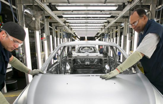 Bob Wright (left) and Terry Wright of UAW Local 5960 members work in the body shop at General Motors Orion Assembly Monday, June 22, 2015 in Orion Township, Michigan - image courtesy of GM