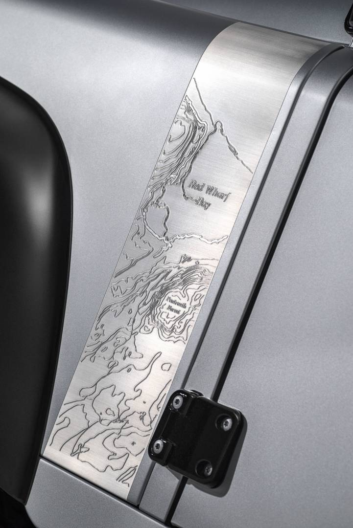 Red Wharf Bay – where the design for the original Land Rover was drawn in the sand – engraved into the aluminium fender.