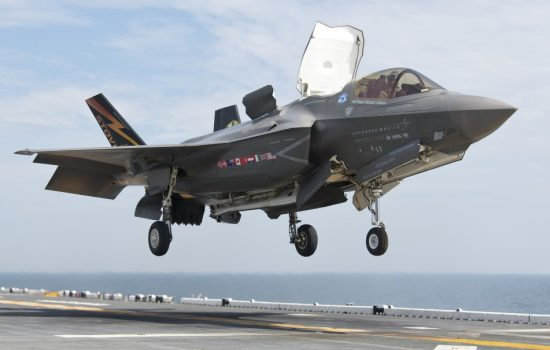 An F-35B makes a vertical landing on an aircraft carrier. Image courtesy of Wikipedia Commons.