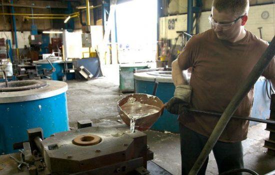 Lukasz Luterek pours metal at Alucast's Wednesbury facility