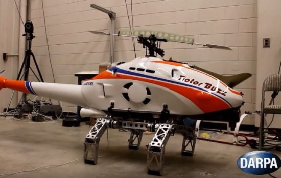 A small helicopter UAV tests Darpa's new robotic landing gear. Image courtesy of Darpa.