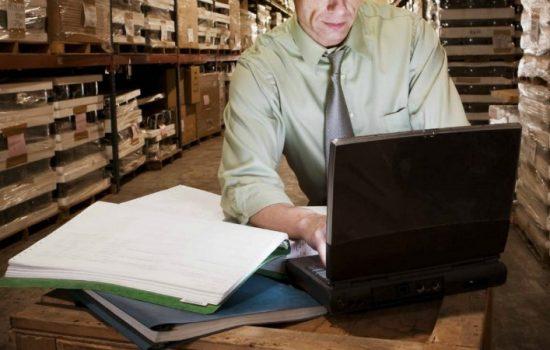Warehouse - Man on Laptop