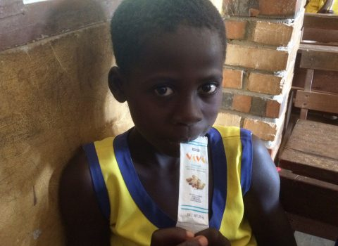 A child in Ghana consuming Vivi, a healthy snack developed as a part of the Hershey Nourishing Minds project - image courtesy of Hershey.