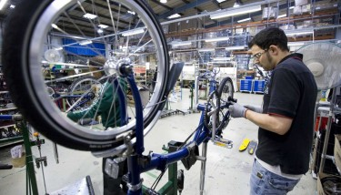 Brompton employee working on the assembly line - image courtesy of The Manufacturer.