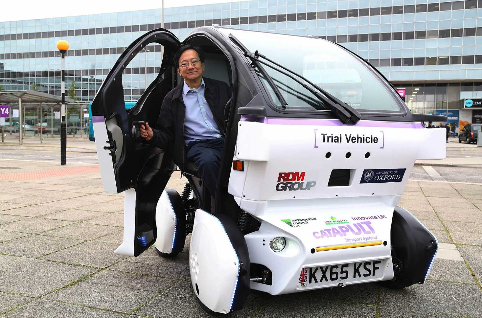 Principal technologist at Transport Systems Catapult Eric Chan unveils the first Lutz Pathfinder pod vehicle developed by Coventry's RDM Group.