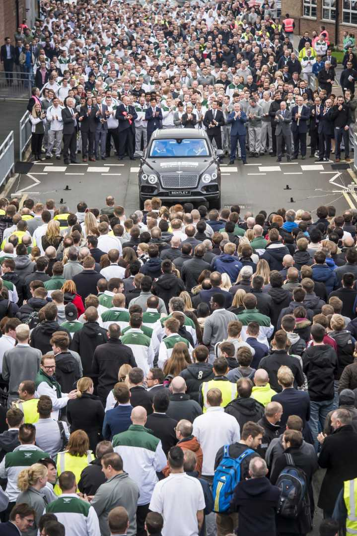 Staff watch on as the first Bentley Bentayga makes it's first trip around the Crewe production facility.