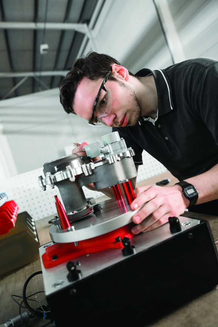 AMRC technician, Jon Hall examines a flexible fixturing solution, a product of Meggitt's CLAAW project.