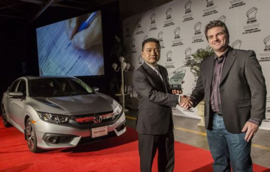 Hayato Mori, senior of product planning for Honda Canada, is presented with the award for the Best New Small Car category at the 2016 Canadian Car of the Year Awards