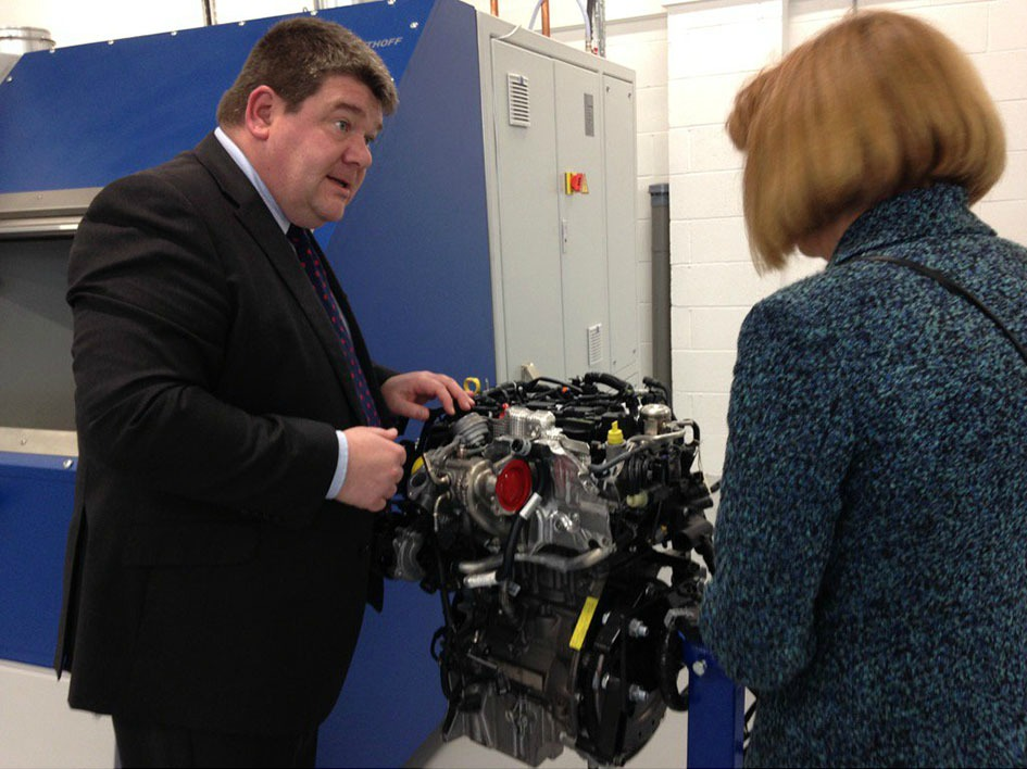 AME's Carl Perrin shows Dr Ruth McKernan one of AME's R&D projects.