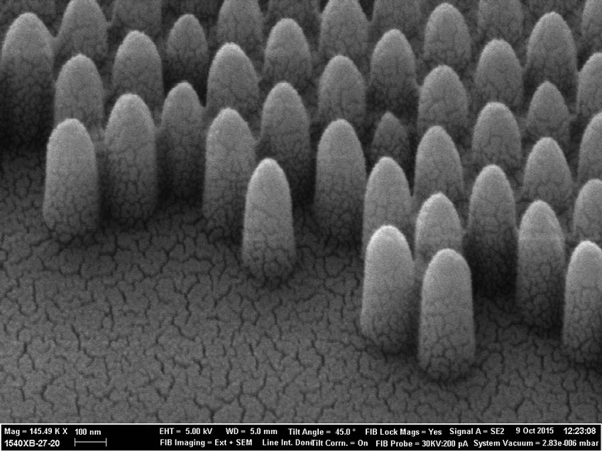 A scanning electron miscroscope photograph shows the pyramid-like nanostructures engraved onto glass: at 200nm they are 100 times smaller than a human hair. Controlling the surface morphology at the nanoscale allows scientists to tailor how the glass interacts with liquids and light with high precision.