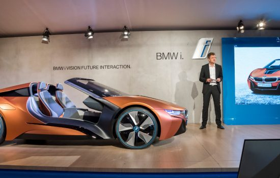 The BMW i8 concept car on display at CES 2016 with Klaus Frohlich, a member of the Board of Management of BMW AG presenting - image courtesy of BMW.