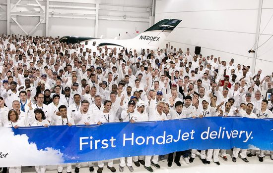 Honda Aircraft Company employees celebrate the delivery of the first HondaJet at the company's world headquarters in Greensboro, North Carolina - image courtesy of Honda