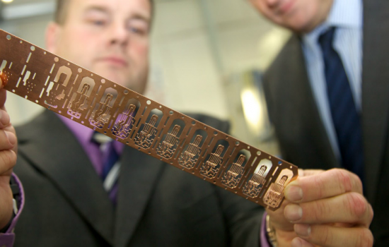 Bruderer UK's Adrian Haller (left) with one of the components made on Bruderer presses.