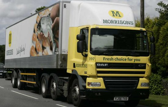 A Morrisons truck travelling on a UK road - image courtesy of Bilbobagweed, cropped and used under creative commons licence
