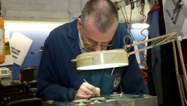 Barkley Plastics' toolmaker, Malcolm Hands finishing up a mould tool ready for first off trials.