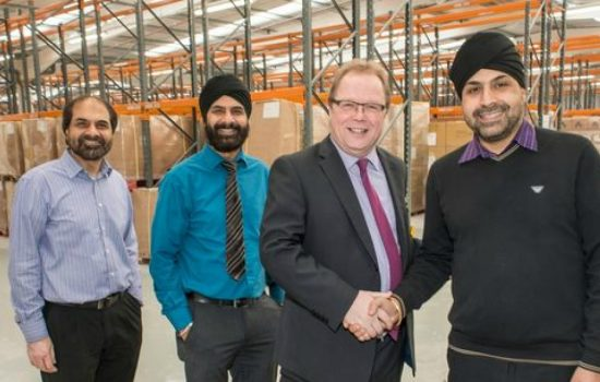 Barclays' Andy Perry with brothers Sohan, Harbans and Kulwant Kalsi (all Kalsi Plastics).