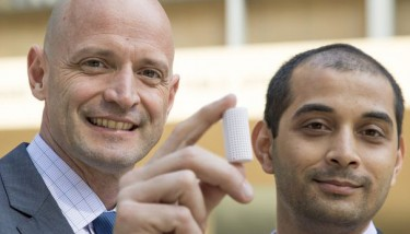 J.R. DeShazo, left, and Gaurav Sant show off a sample of the new building material made from CO2 that they hope will one day replace concrete - image courtesy of UCLA.