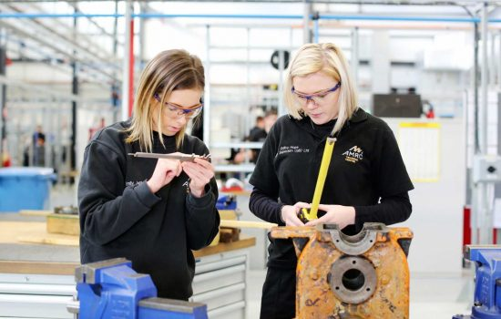 Two AMRC Training Centre apprentices on the workshop floor.