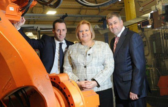 Rachel Eade with Steve Platt (L) and Rcihard McCulloch (both CAB Automotive).