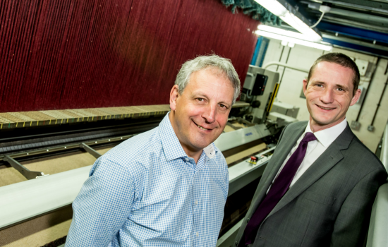 Chief executive of Wilton Carpets, MacAdam Sprint, and Stuart Williams, regional manager at Lloyds Bank Commercial Banking.