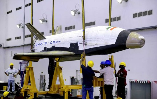 The RLV-TD space plane being prepared for launch. Image courtesy of ISRO.