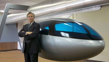 skyTran CEO, Jerry Sanders with an example of one his company's MagLev tranportation pods - image courtesy of skyTran