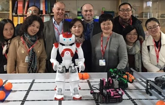 Chinese delegates visit Finham Park School. Back row, 2nd from L is Andy Mitchell, assistant chief executive (D&T Association), and 3rd from L is Pete McGuire, head of engineering (Finham Park School).