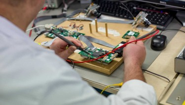 Surgical precision - An Integrated technologies Ltd technician tests a mission-critical PCB