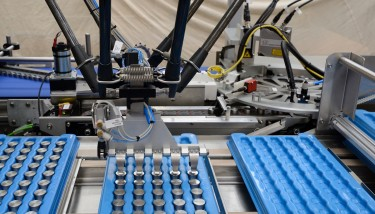 The new high speed packaging system eliminates all manual handling of finished magnetic components. A 'pick and place' robot transfers five components at a time into specially-designed trays ready for shipment – image courtesy of Innomech/Phil Mynott.