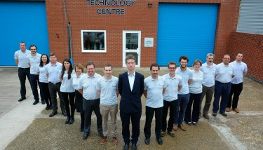 culture of innovation - Founder and CEO, Steve Lindsey stands outside Lontra's new Technology Centre with his skilled team of engineers – image courtesy of Lontra.