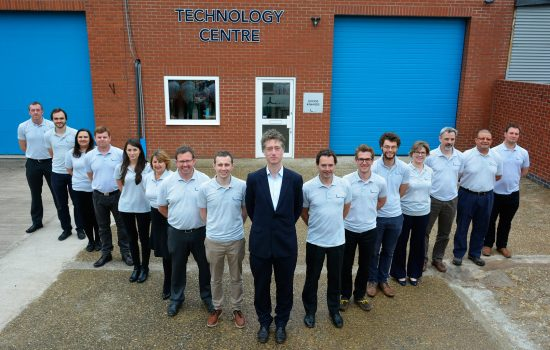 Founder and CEO, Steve Lindsey stands outside Lontra's new Technology Centre with his skilled team of engineers – image courtesy of Lontra.