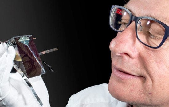 Dr Mark Keevers with one of the spectrum splitting, four-junction mini-modules developed at UNSW to improve solar cell efficiency - image courtesy of UNSW.