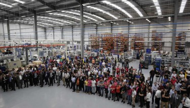 HydraForce staff and guests on factory floor LR